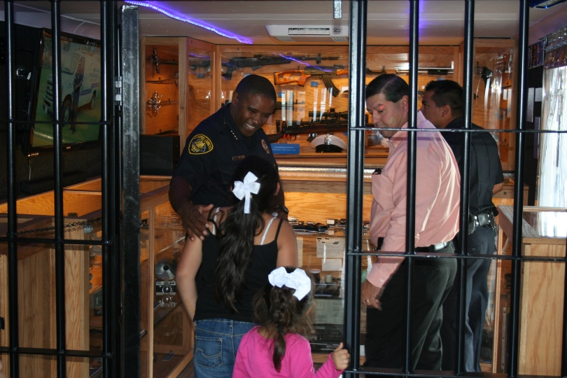 Corpus Christi Police Chief Floyd Simpson invites children to look through the new Corpus Christi Police museum