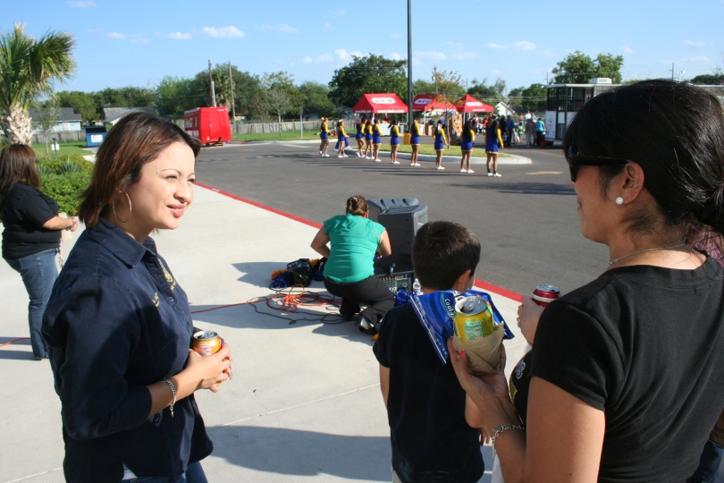 Corpus Christi Police Crime Prevention Advisor Brenda Moreno (left) speaks to a family at the National Night Out.