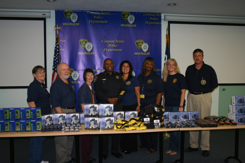Corpus Christi Police Chief Floyd Simpson stands with members of the Citizens Police Academy Alumni behind the donated equipment