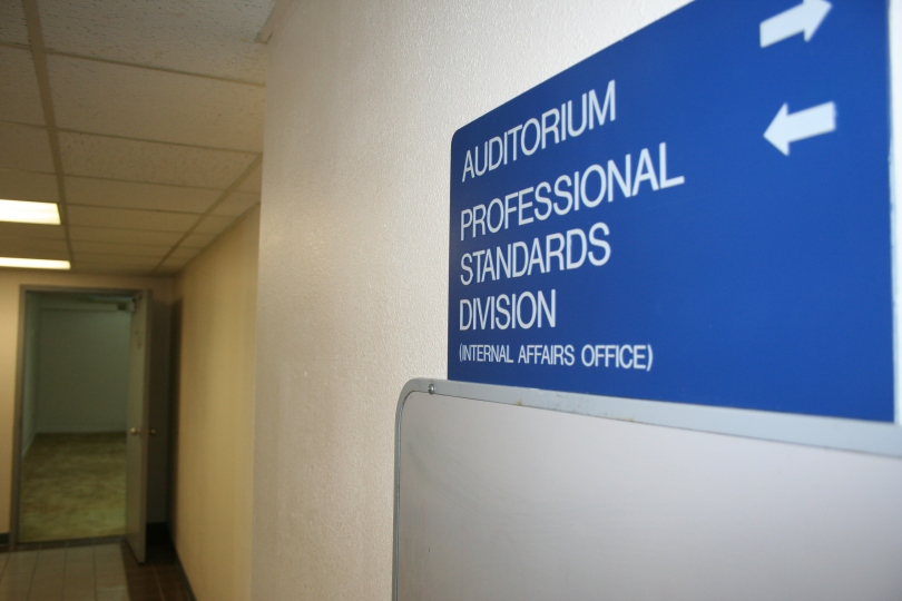 The directional sign on the 5th floor of Police Headquarters for the Professional Standards Unit points to an empty room now that the unit has relocated to 5805 Williams Drive