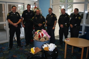 "Corpus Christi Police Officers Justin Wicks, Jason Lee, Assistant chief Mike Markle, Captain Ed Shannon, Bob Dorche, and Rodney Cantu delivered stuffed animals and ""get well"" cards to patients at Driscoll Children's Hospital on December 21."