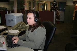 Christa Garrison is a dispatcher at her work station on the 4th floor at Police Headquarters
