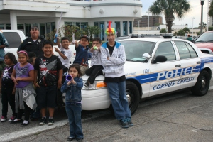 Corpus Christi Police Senior Officer Diaz stood with nearby children at John Sartain Street and Shoreline excited to see the parade
