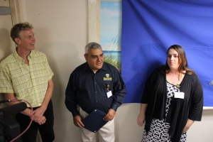 (Left to right) local artist Patrick Richard, Metrocom supervisor, Ronnie Sepulveda, and 911 Program Manager, Kathleen Porche unveilled the mural in Metrocom today.