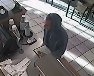 Detectives have asked the public to help identifty this robbery suspect